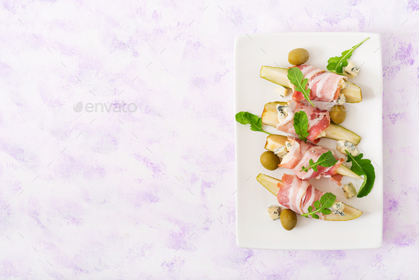 Appetizer with pear, blue cheese, prosciutto ham and toast for holidays - Stock Photo - Images