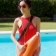 Serious Woman in Lifeguard Uniform Beside Pool - VideoHive Item for Sale