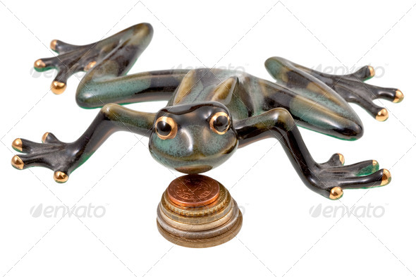 ceramic frog and coins - Stock Photo - Images