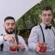 Smiling Bartenders Behind Bar, Barman Making Cool Drink in Glass, Bartender Decorate Cocktails - VideoHive Item for Sale