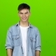 Guy Cute Smiles and Shows Two Thrumbs Up. Green Screen