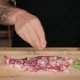 Man Marinates and Seasons Fresh Steak with Spices