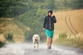 Man with dog in heavy rain - PhotoDune Item for Sale