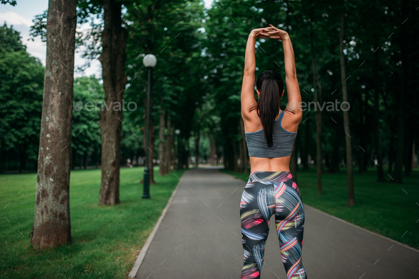 Athletic girl on fitness training in summer park - Stock Photo - Images