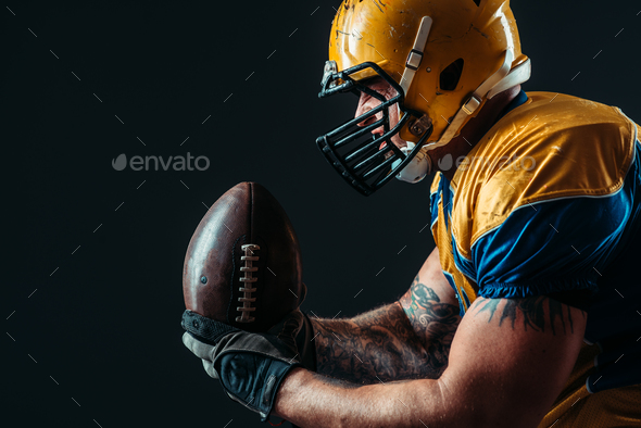 American football offensive player with ball - Stock Photo - Images