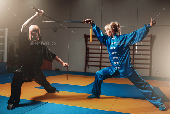 Wushu fighters, man and woman with swords - Stock Photo - Images