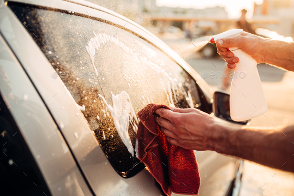 Male hand with tool for washing windows, car wash - Stock Photo - Images