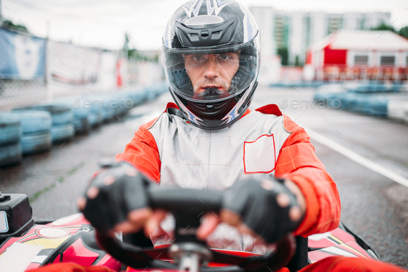 Carting race, go kart driver in helmet, front view - Stock Photo - Images