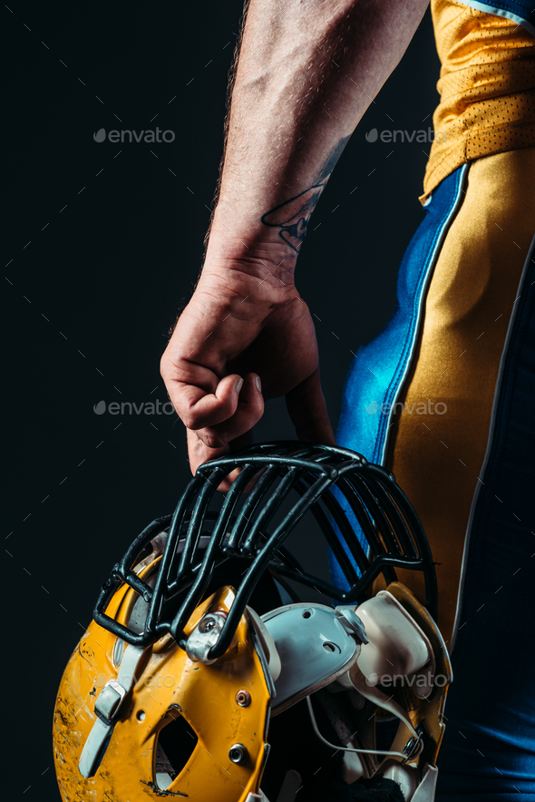 Male person in uniform with football helmet - Stock Photo - Images