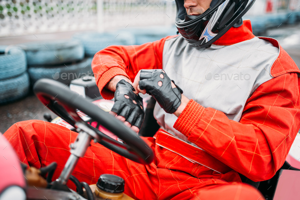 Go-kart driver in helmet on karting speed track - Stock Photo - Images