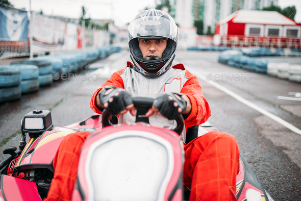 Karting race, go cart driver in helmet - Stock Photo - Images