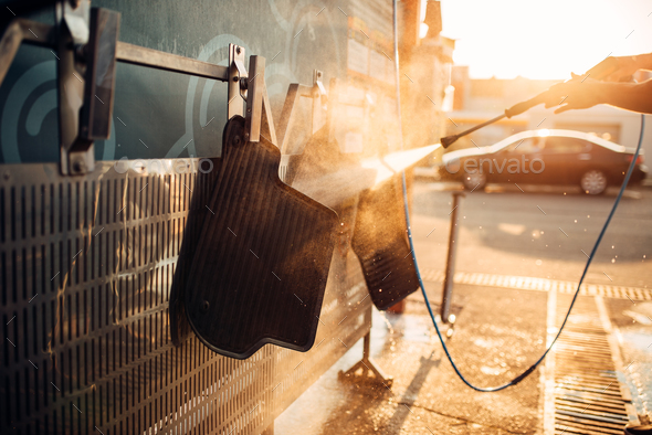 Car carpets washing with high pressure washer - Stock Photo - Images