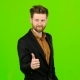 Male Businessman Showing Thumbs Up, He Likes Everything. Green Screen