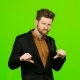Man Watches a Movie and Punches His Finger Down. Green Screen