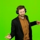 Guy Listens To Music in Headphones and Dances. Green Screen