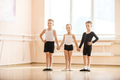 Young boys and a girl with posing at ballet dancing class