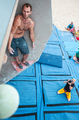 Male climber before jump on artificial climbing wall