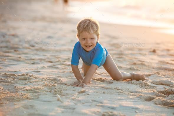 Little boy having fun on the beach