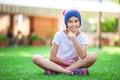 Cheerful young girl sitting on the grass
