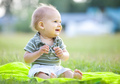 Happy small boy outdoors in a park