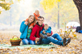 Happy young family with two boys in autumn forest
