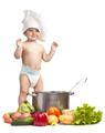 Little boy in chef's hat playing with casserole and vegetables - PhotoDune Item for Sale