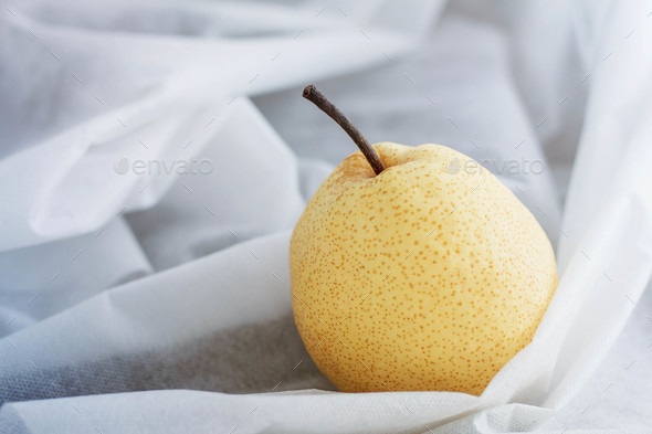 pear on white tablecloth - Stock Photo - Images