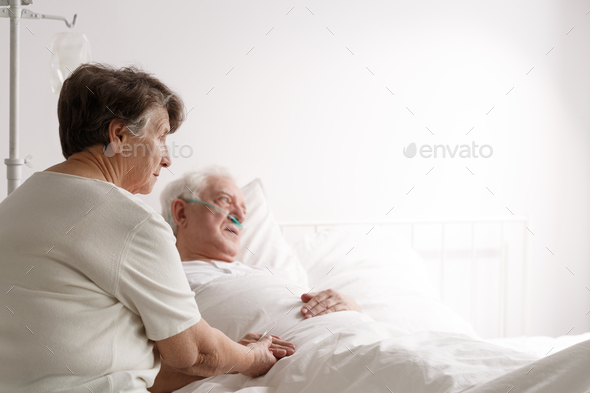 Senior woman supporting sick husband - Stock Photo - Images