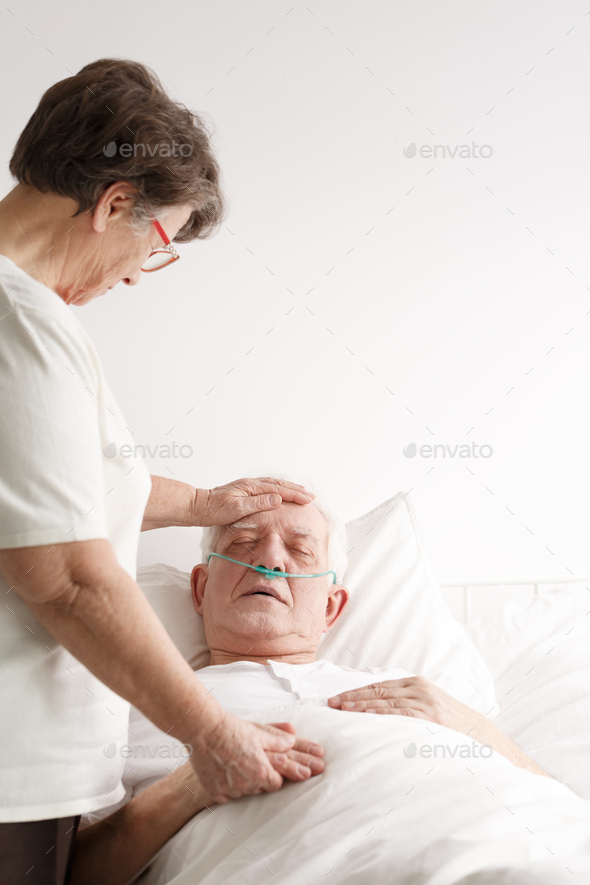 Senior woman supporting her sick husband - Stock Photo - Images