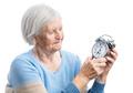 Senior woman holding a clock - PhotoDune Item for Sale