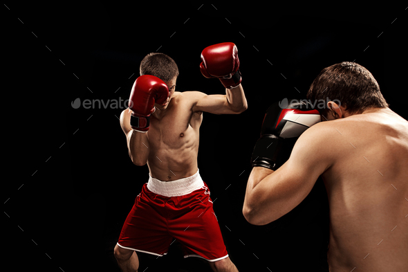 Two professional boxer boxing on black background, - Stock Photo - Images