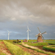 old windmill and turbines at rainy sunset - PhotoDune Item for Sale