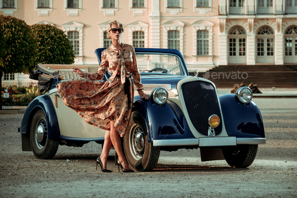 Beautiful lady with bag near classic convertible - Stock Photo - Images