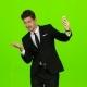 Businessman Walks, Thumbs a Notebook, and Makes a Selfie. Green Screen