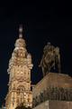 Public Statue and Skyscraper at Night - PhotoDune Item for Sale