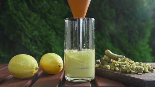 VideoHive The Cook Blends Sauce Ingredients in a Long Glass Cooking Outdoors Cooking Food Vegetarian Meals 20320876