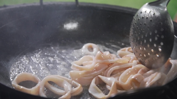 VideoHive Rings of Calamari Are Frying in the Boiling Oil on the Open Fire Grilling Squid Seafood Meal 20320890