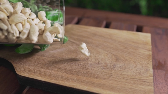 VideoHive Cashew Nuts Falls on the Wooden Board Ingredients for Pesto Sauce Vegetarian Food Diet and 20321128