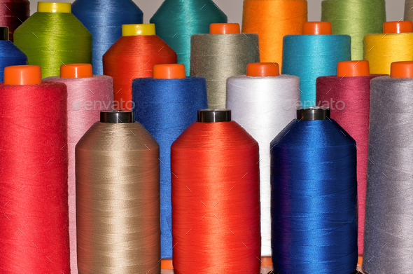 Colour spools in many colours - Stock Photo - Images