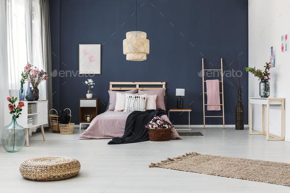 Dark blue wall in bedroom