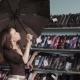 Woman Chooses an Umbrella in Shop