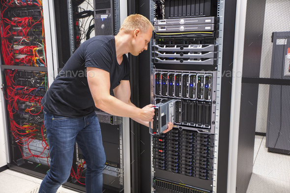 Computer Engineer Installing Blade Server In Datacenter - Stock Photo - Images