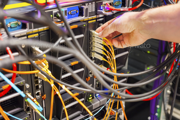Hand Plugging Fiber Cable Into Switch In Datacenter - Stock Photo - Images