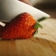 Chief Cuts Strawberry on Professional Kitchen - VideoHive Item for Sale