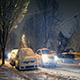 Cars Pass Houses At Night In Blizzard - VideoHive Item for Sale