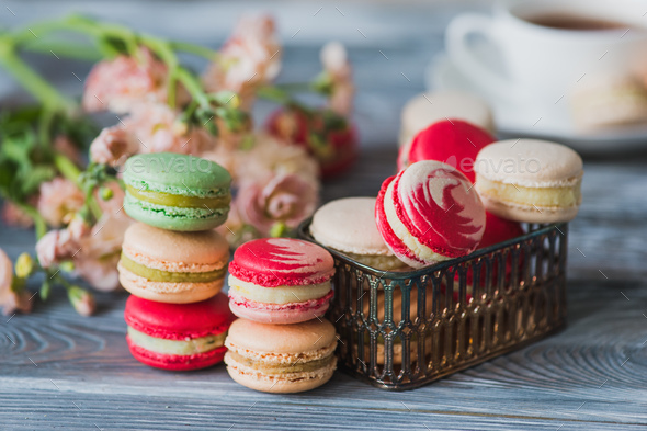 Love gift with flowers and macarons - Stock Photo - Images