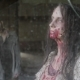 A Zombie Girl Stands and Looks Out the Window From an Abandoned Building. - VideoHive Item for Sale