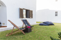 summer apartment garden with chairs and pillows setup - PhotoDune Item for Sale