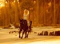 woman in medieval dress on horseback