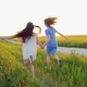 Two Happy Funny with Long Hair Young Girls Running on the Wheat Field - VideoHive Item for Sale